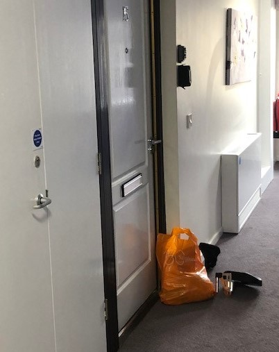 Shopping bags outside someone's door