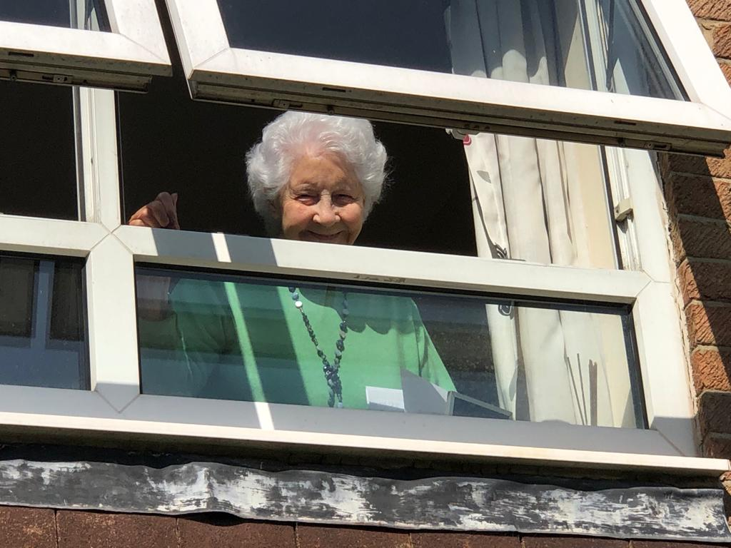 100 year old Winnie enjoying the celebrations from her window